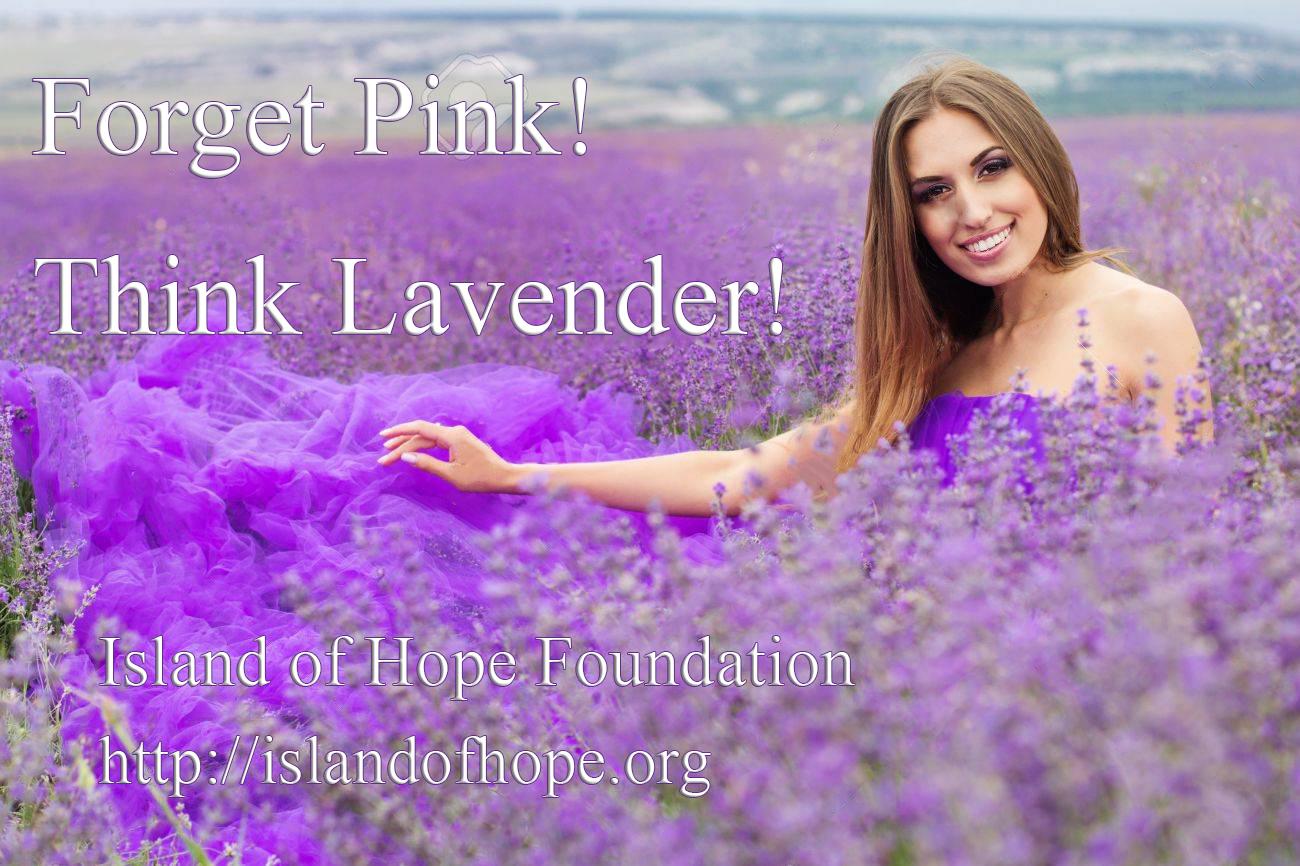 Beautiful woman is posing at field of purple lavender flowers